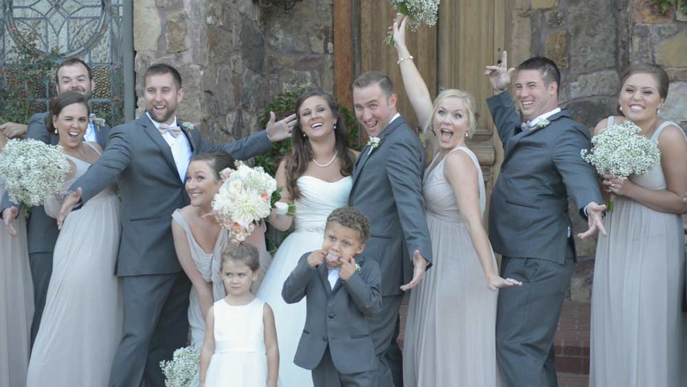 funny wedding party photo in front of Matt Lane Farm