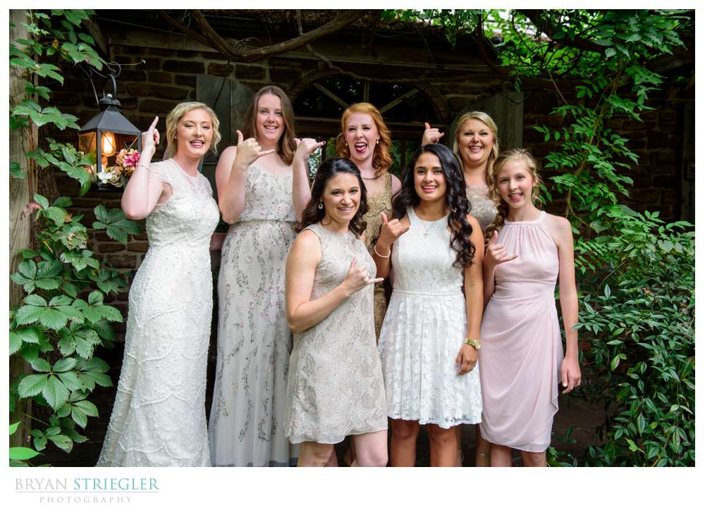bride and bridesmaids with gang signs