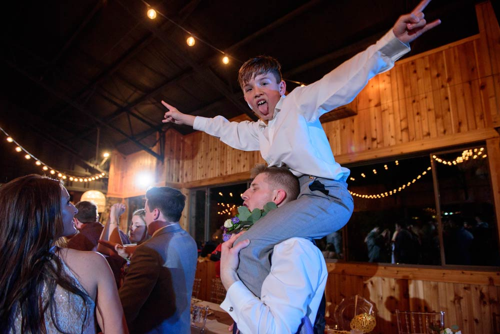 ring bearer dancing on shoulders